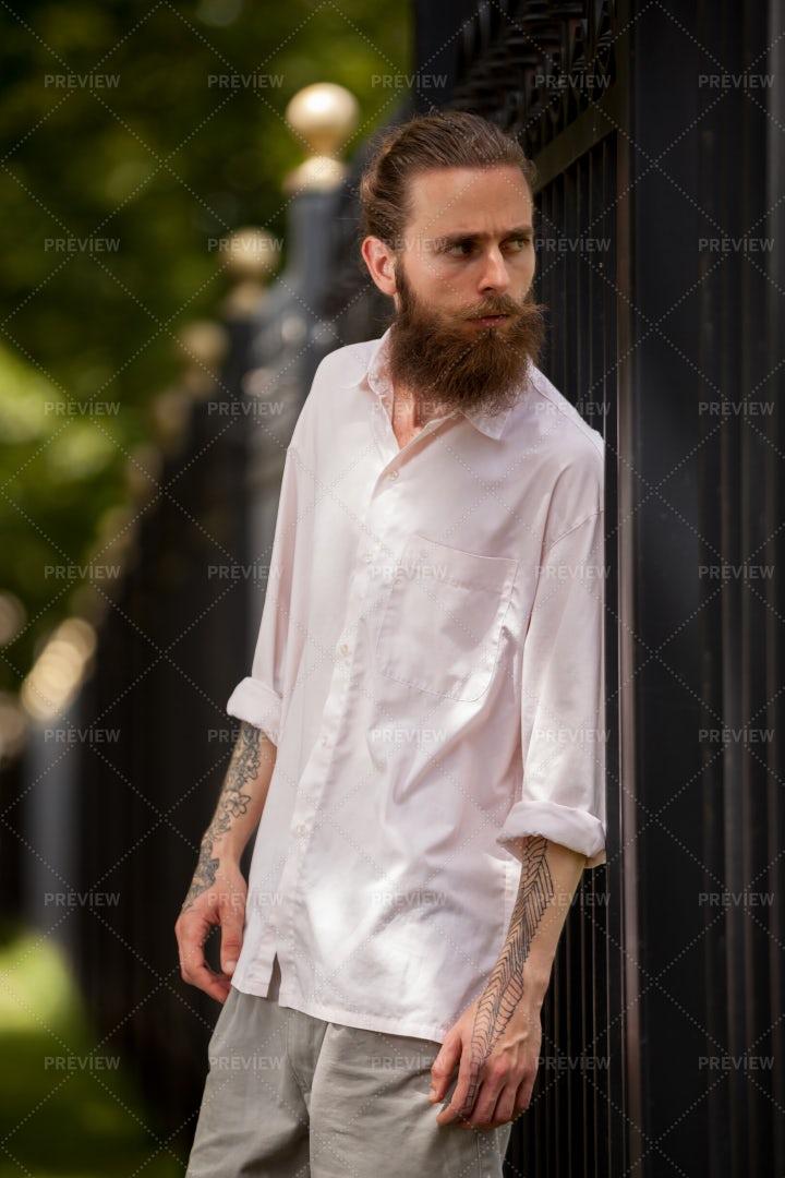 Man Peering Through Gates: Stock Photos