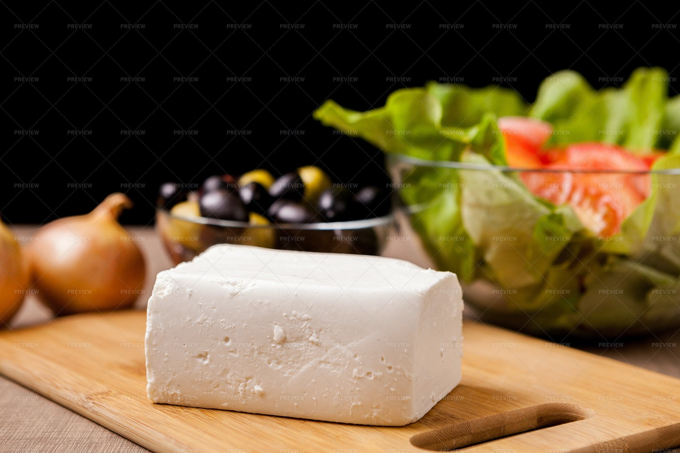Close Up On Feta Cheese On Wooden Board: Stock Photos