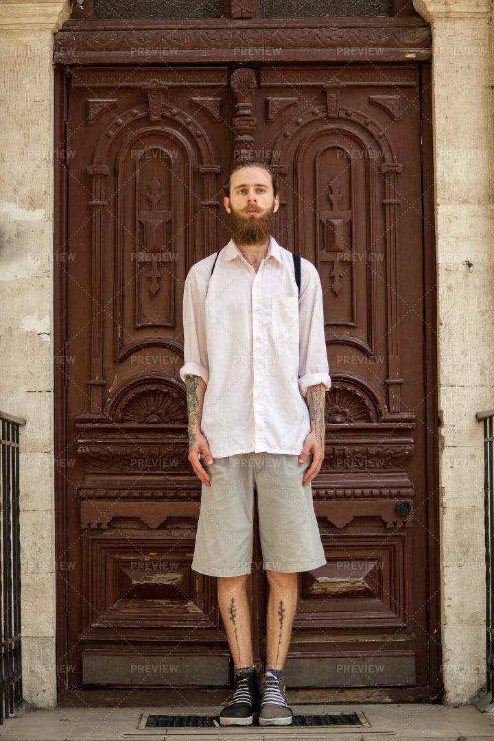 Hipster In Old Doorway: Stock Photos