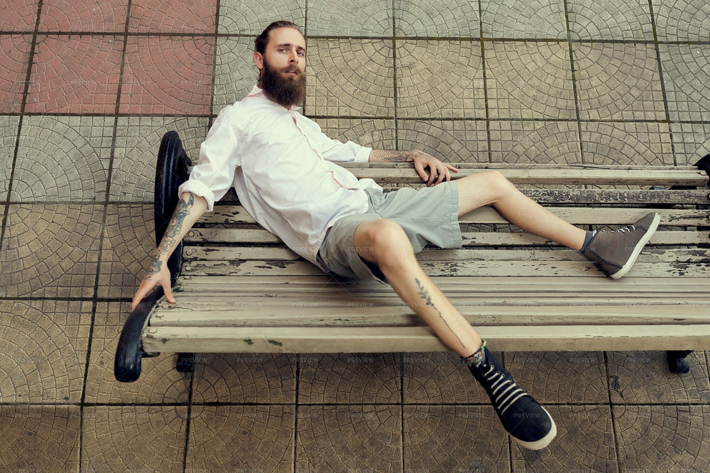 Hipster Leaning On Bench: Stock Photos