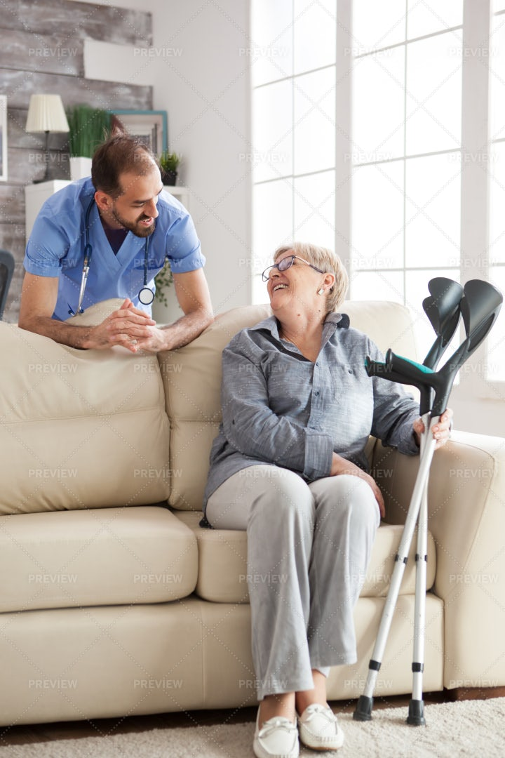 Visiting Woman With Crutches: Stock Photos
