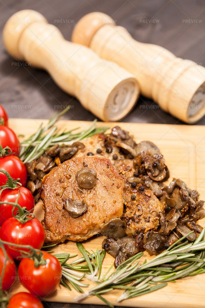 Seasoning Pork Chops: Stock Photos