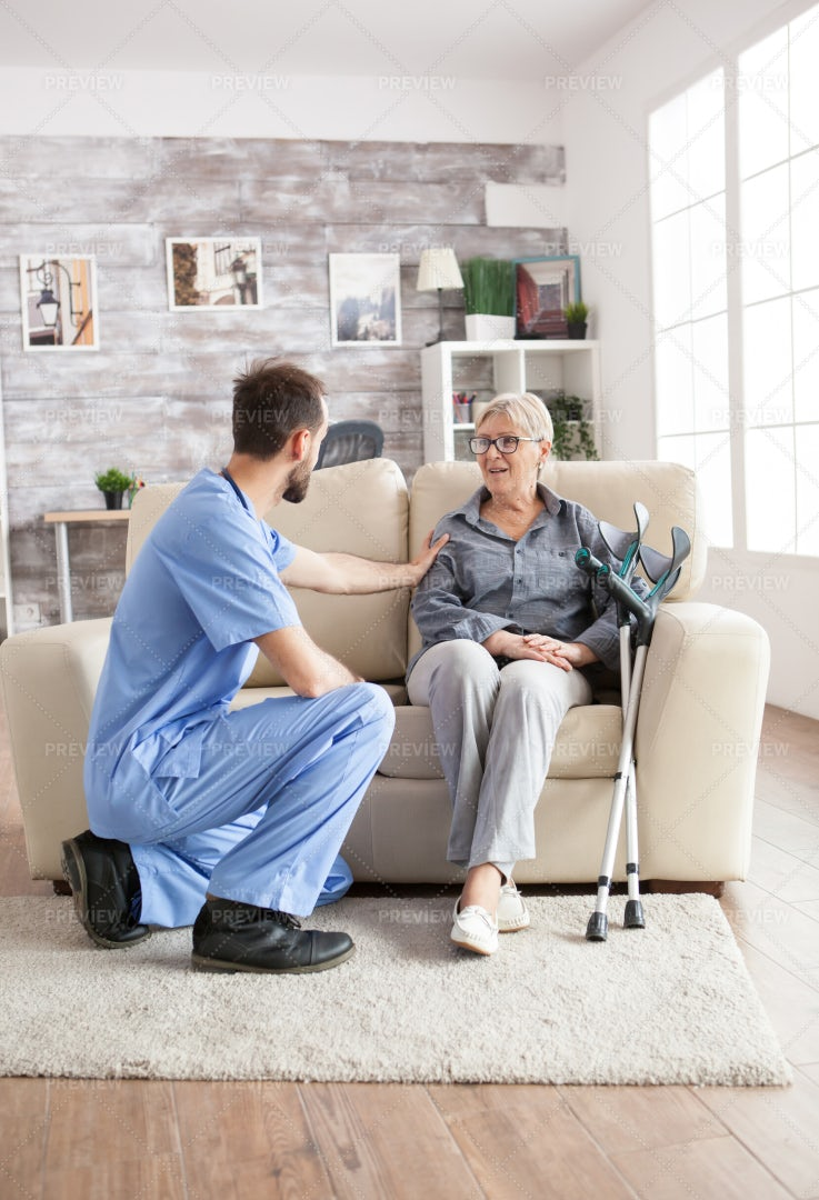 Male Health Visitor In A Nursing Home: Stock Photos