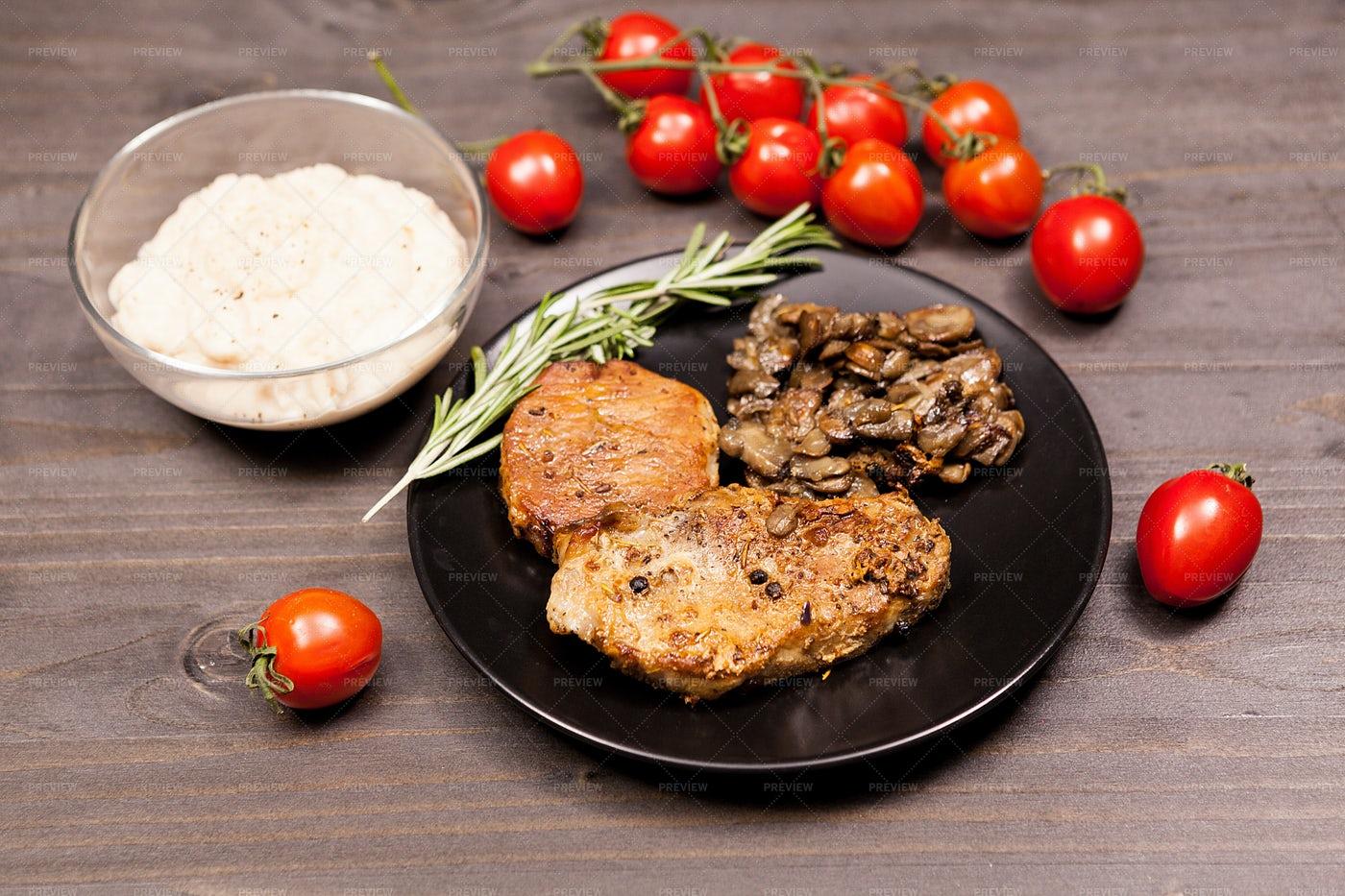 Pork And Mushroom Plate: Stock Photos