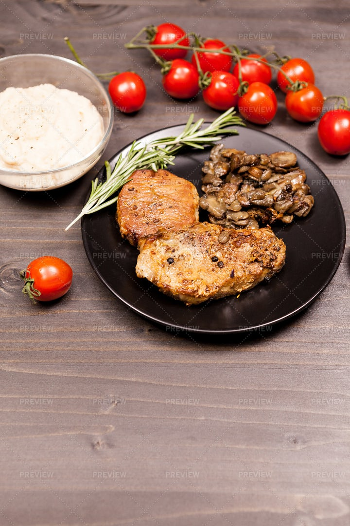 Pork Chops With Tomatoes And Dip: Stock Photos
