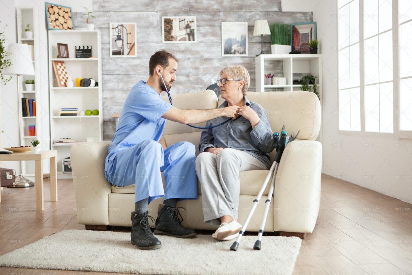 Nurse With Stethoscope Checks Woman: Stock Photos