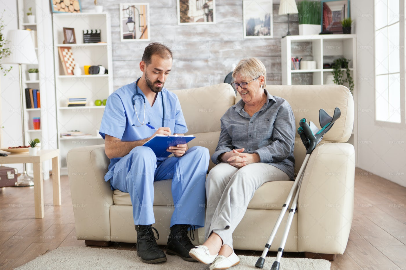 Laughing With Doctor At Nursing Home: Stock Photos
