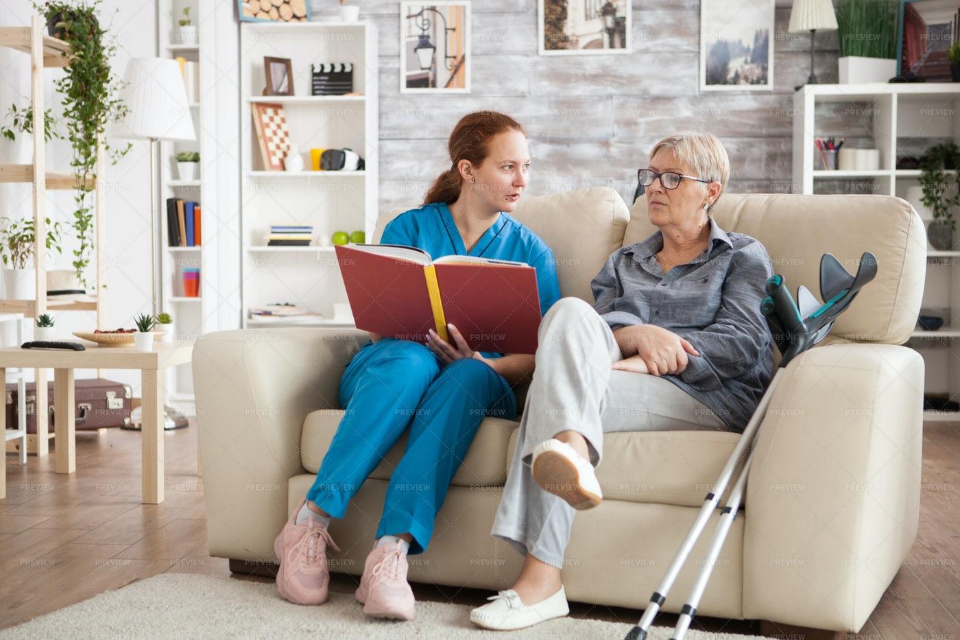 Female Nursing Reading A Book: Stock Photos