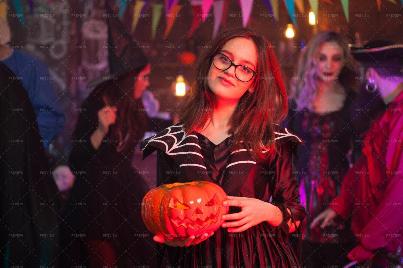 Pumpkin Between A Girl´s Hands: Stock Photos