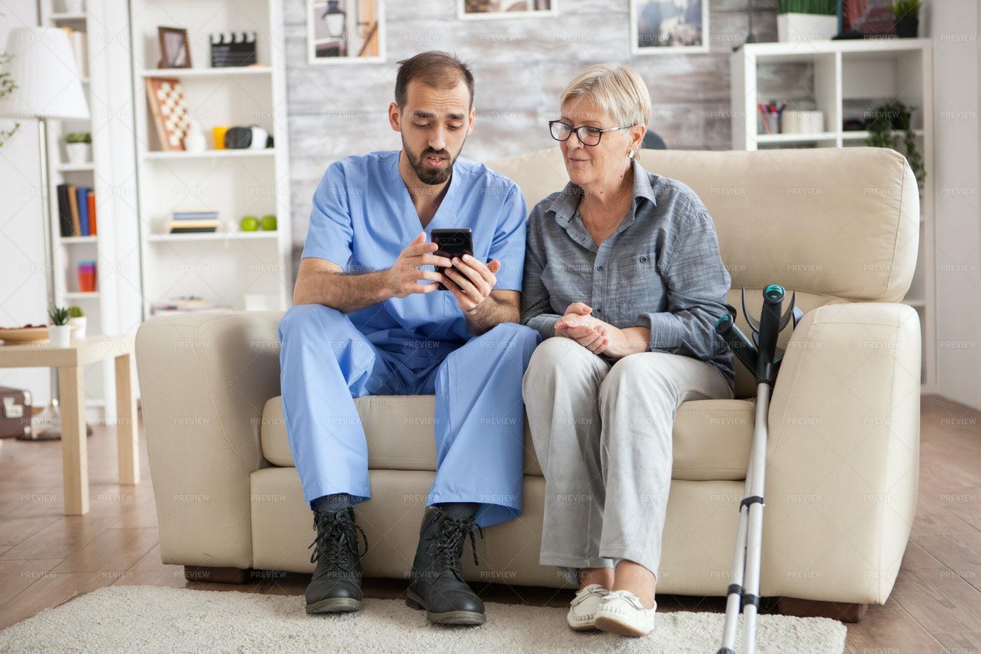 Male Nurse Sets Up Healthcare App: Stock Photos