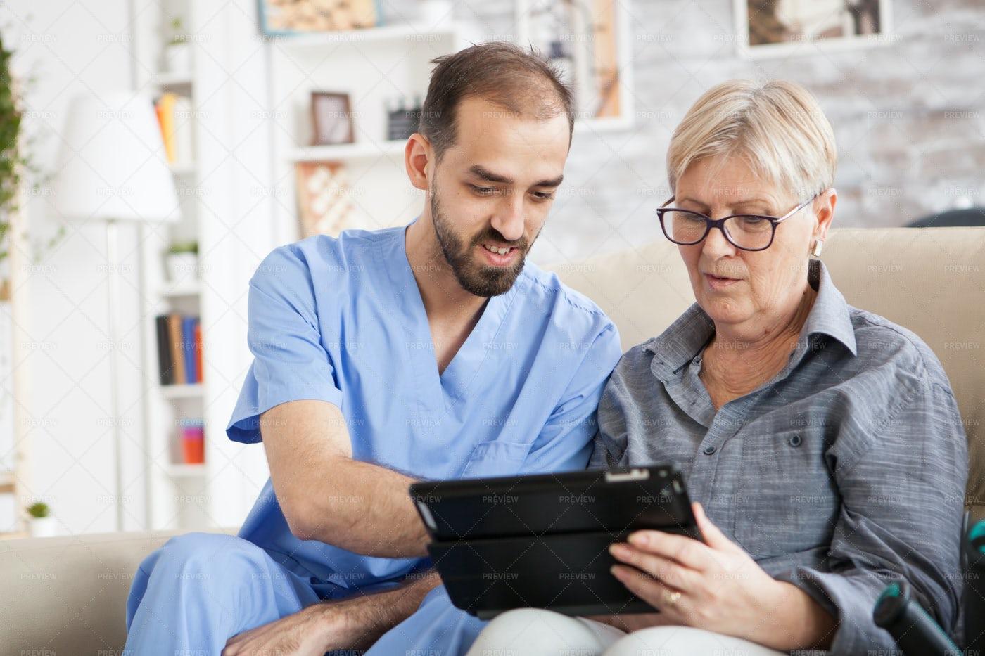 Nurse Helping Elderly Woman: Stock Photos
