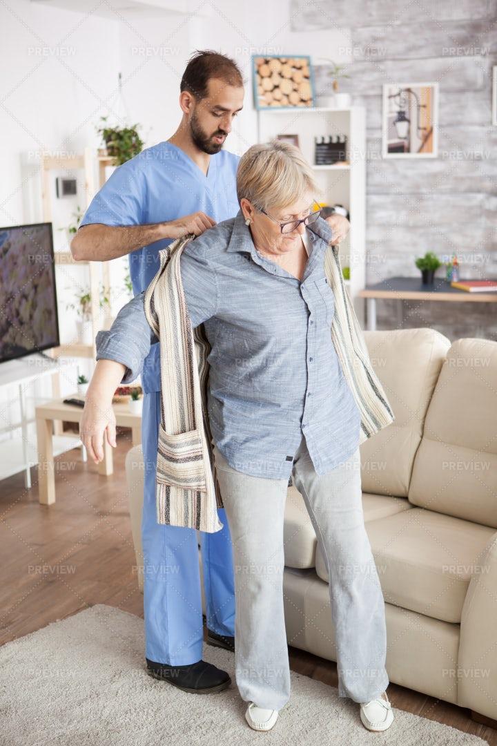 Caregiver Dressing Patient: Stock Photos