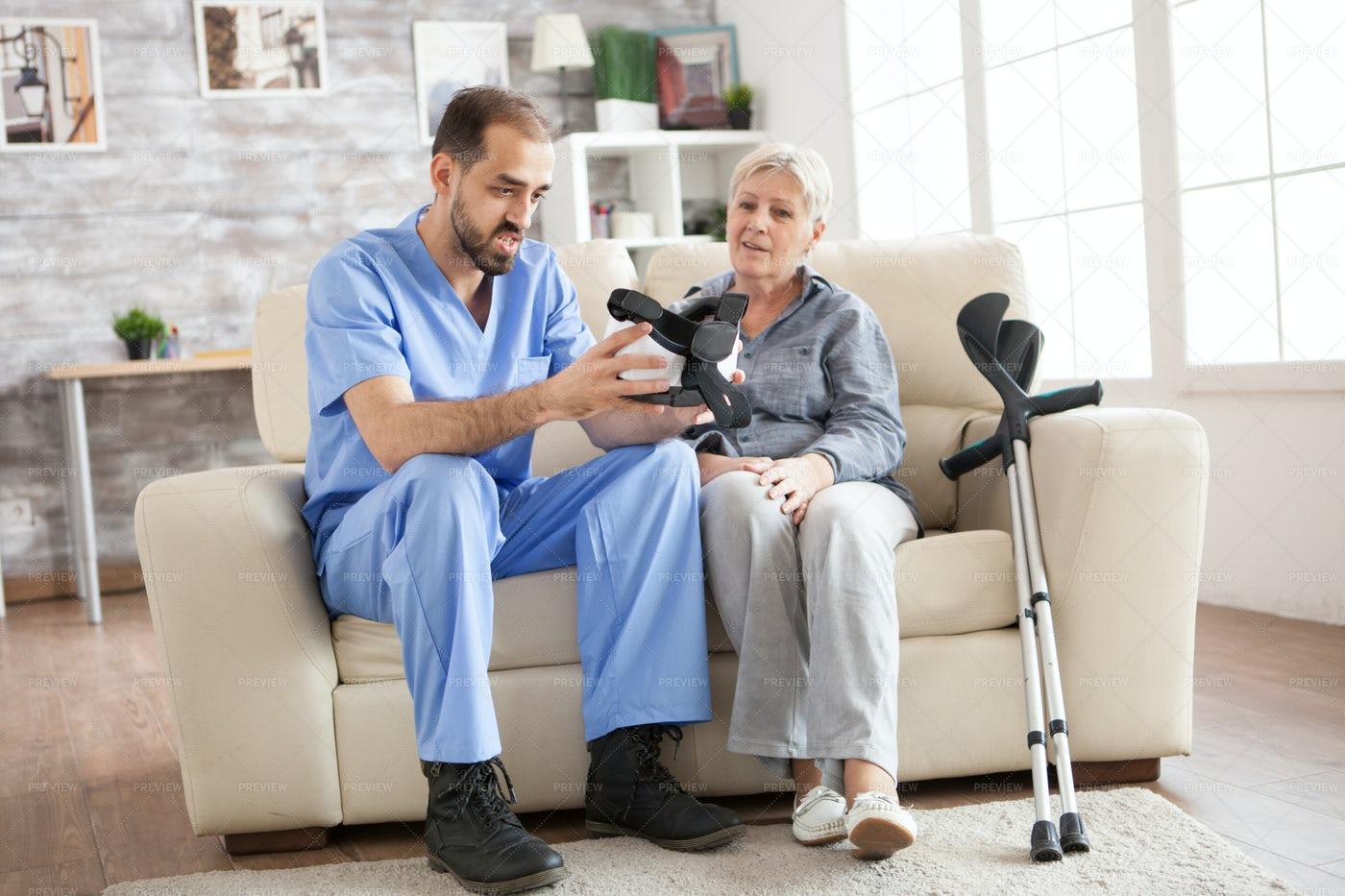 Nurse Explaining VR Technology: Stock Photos