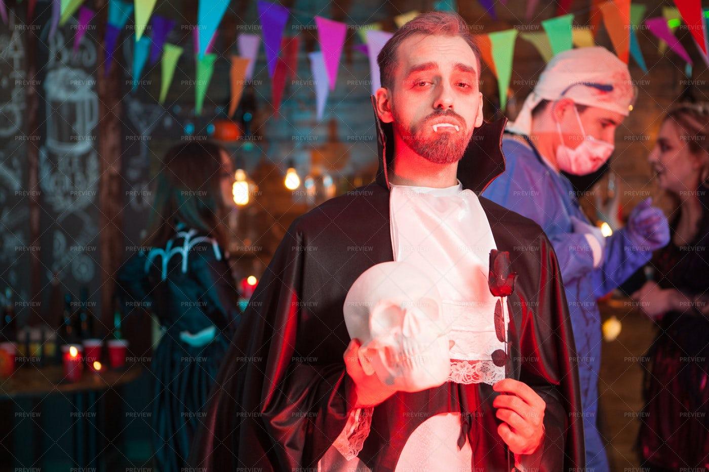 Dracula Holding A Skull: Stock Photos