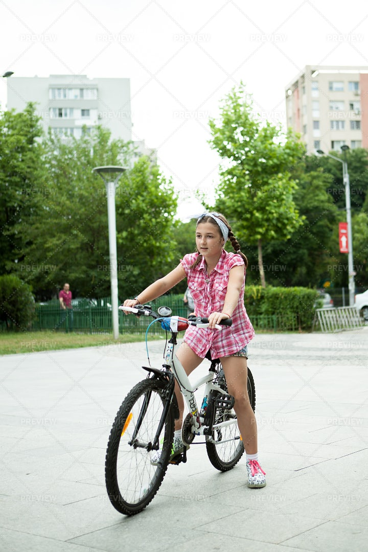 Girl In The Park With Her Bicycle: Stock Photos