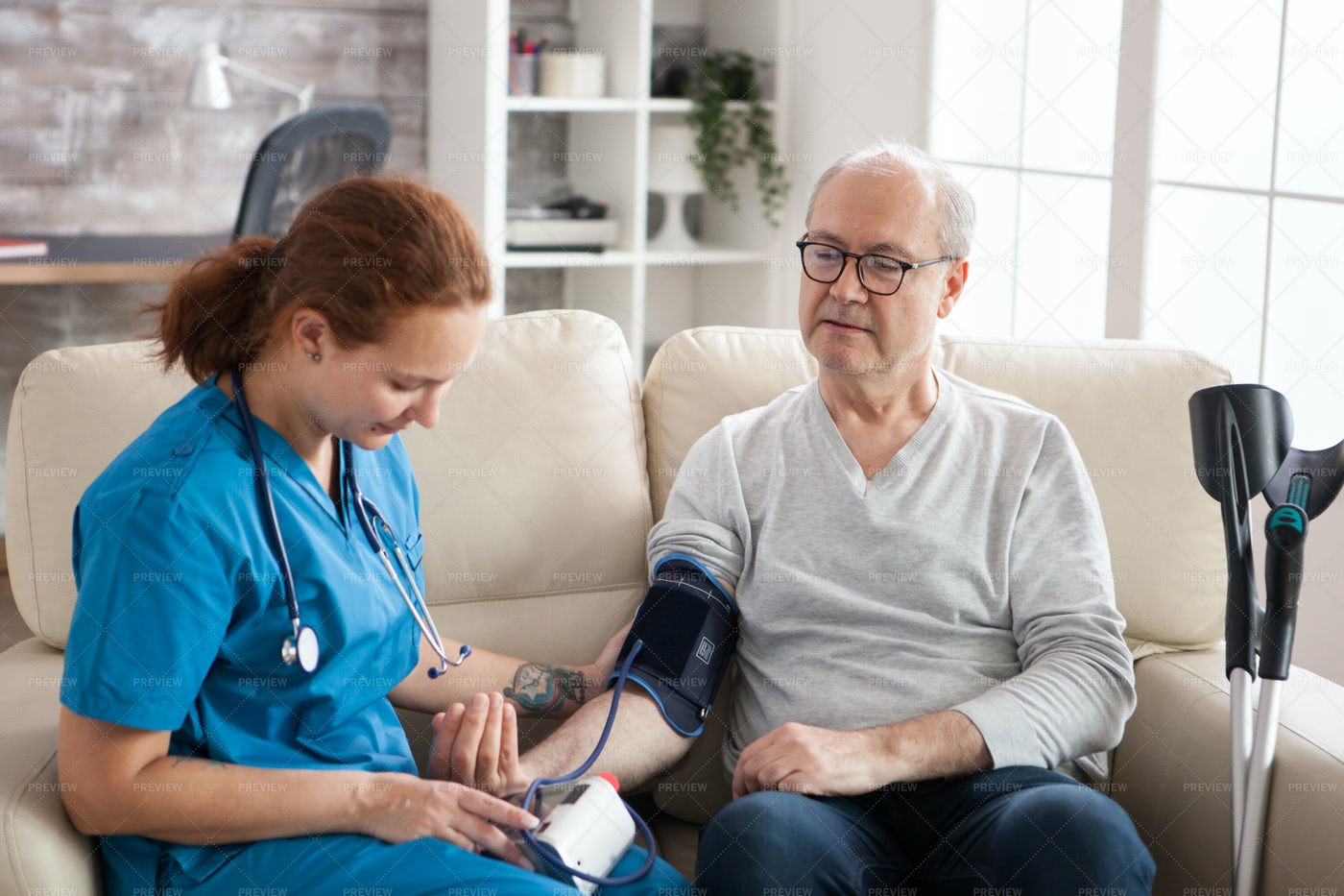 Female Doctor Reading Blood Pressure: Stock Photos