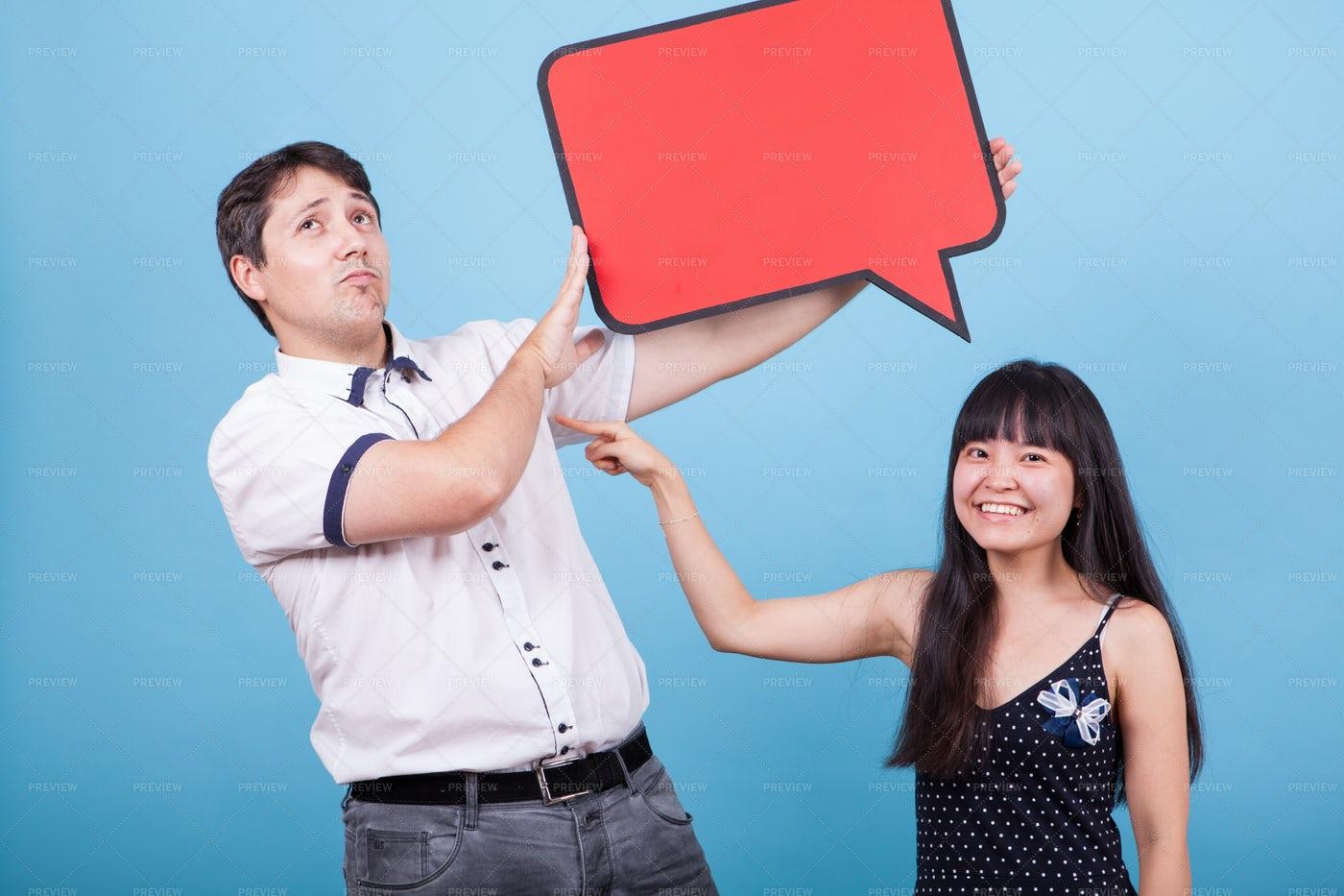 Girl Pointing At Partner: Stock Photos