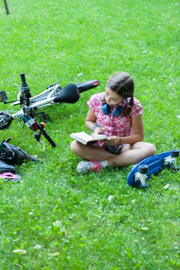 Girl Reading A Book: Stock Photos
