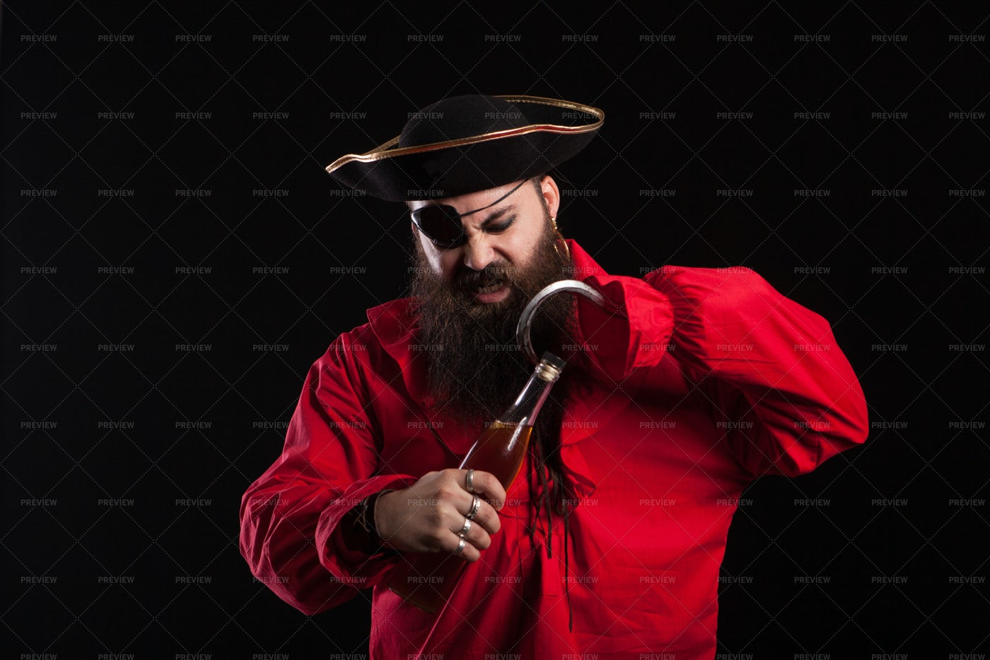 Pirate Opens Beer: Stock Photos