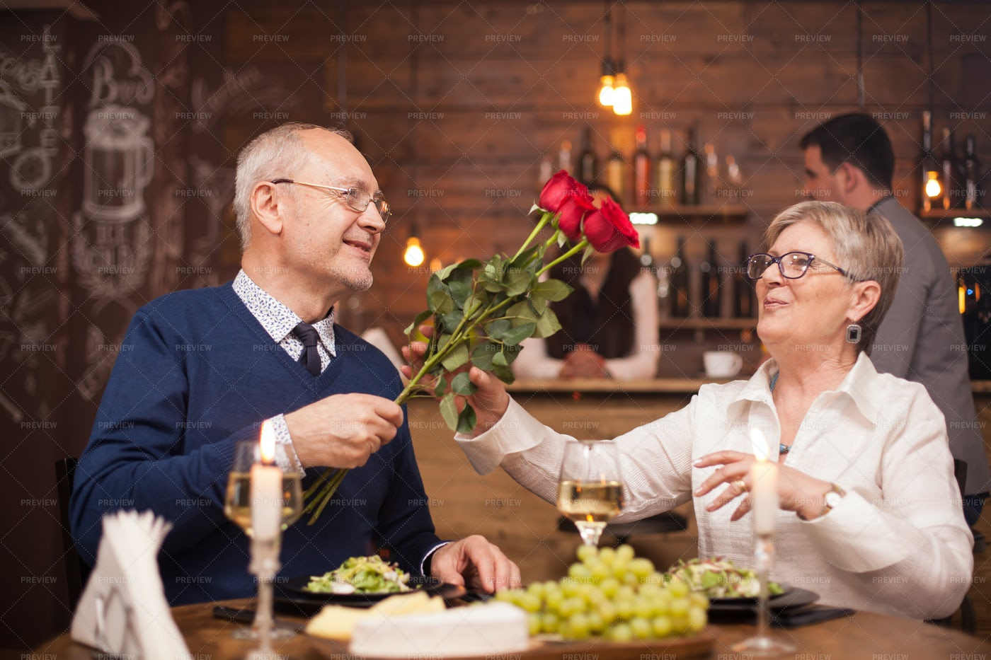 Partner Giving Roses: Stock Photos
