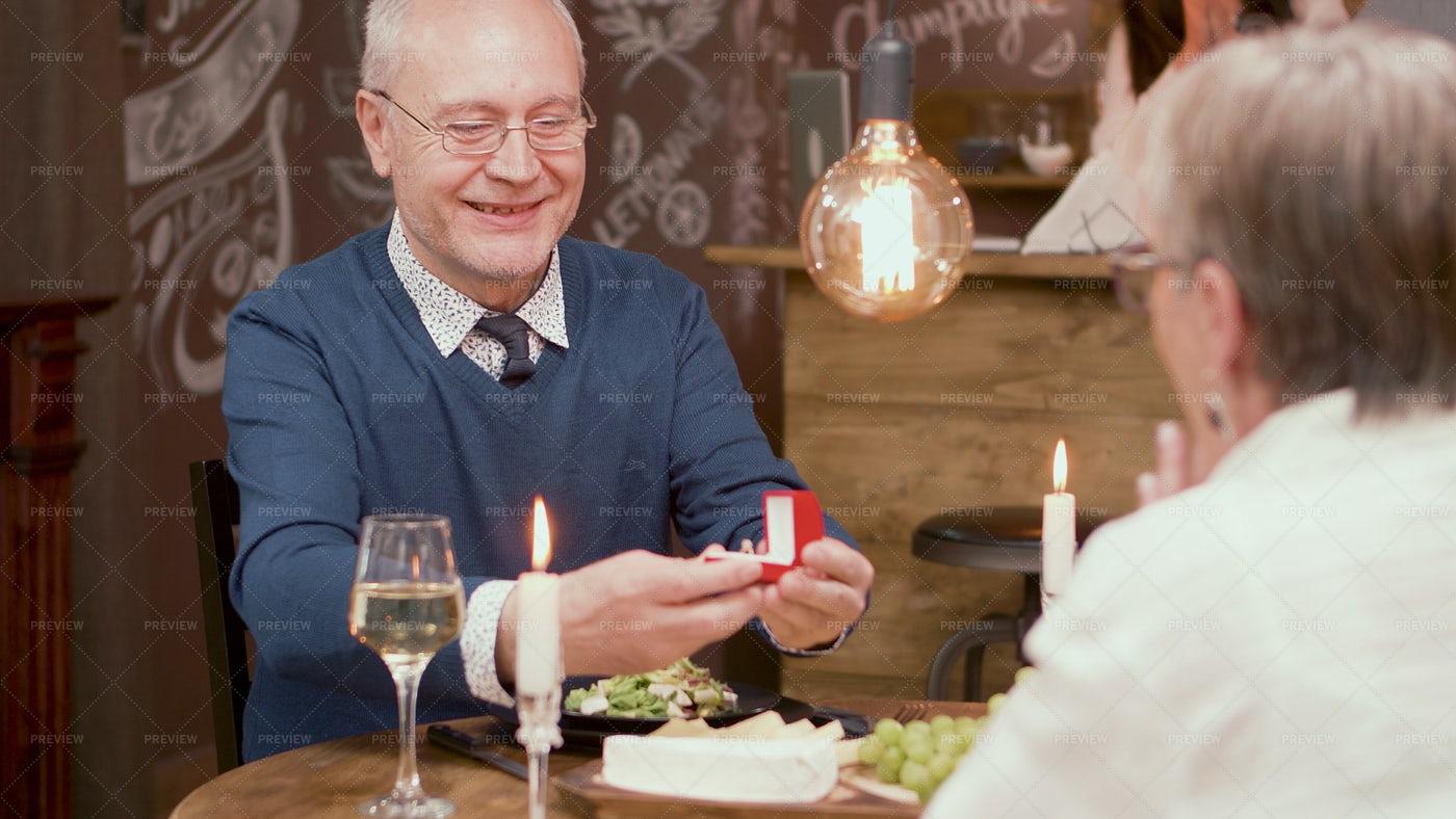 Senior Couple Proposing: Stock Photos