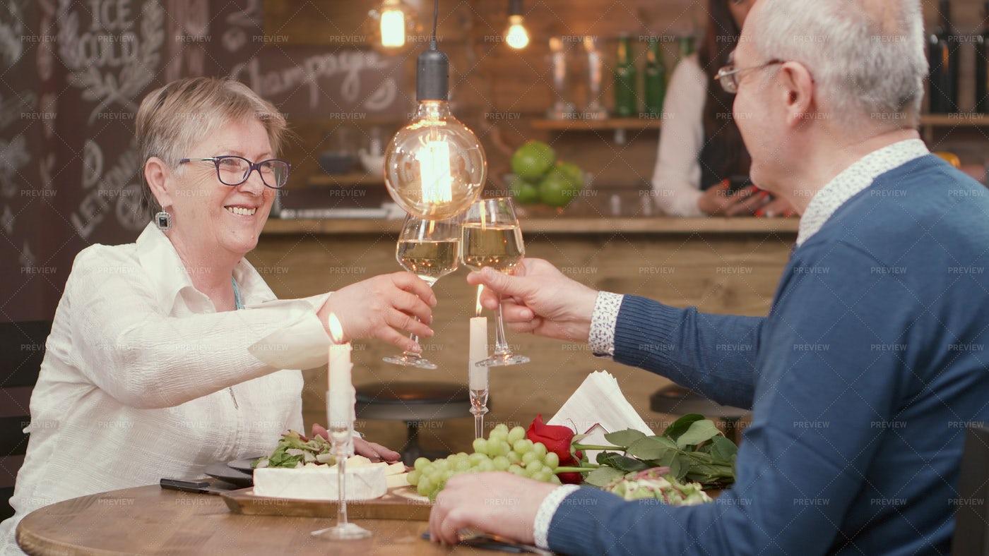 Toasting Drinks Over Dinner: Stock Photos