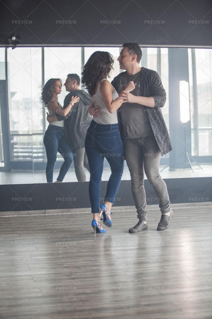 Dancers Practice In Studio: Stock Photos