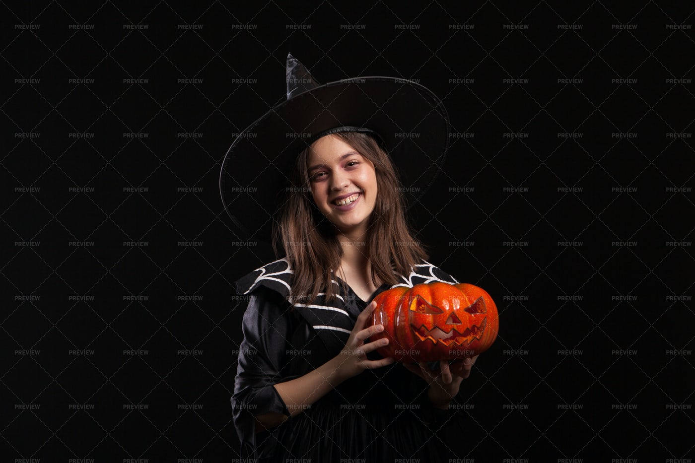 Spider Witch Holding Pumpkin: Stock Photos