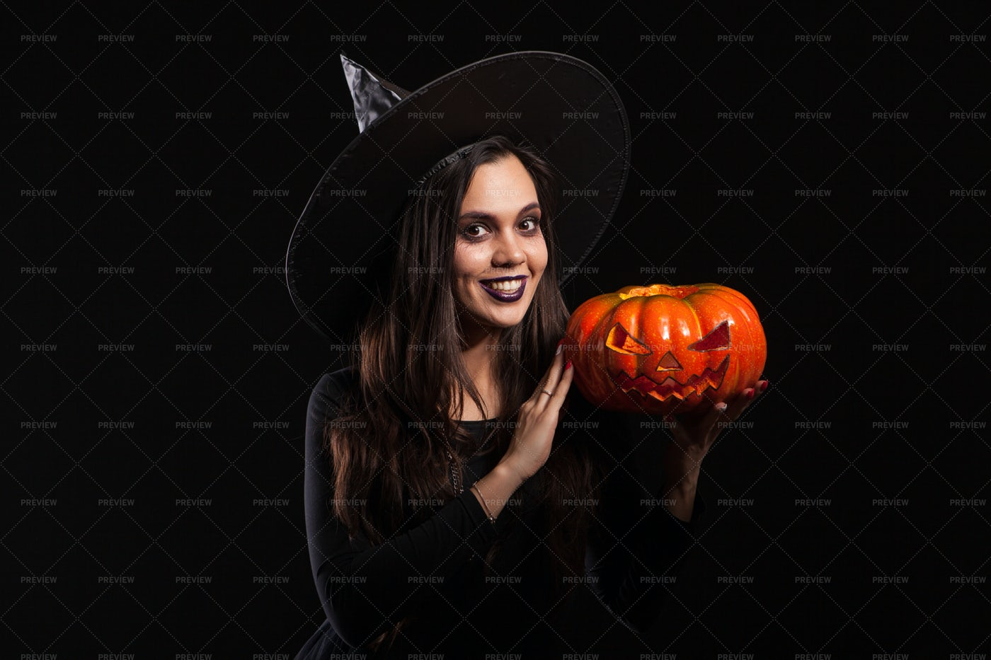 Smiling Witch With Pumpkin: Stock Photos