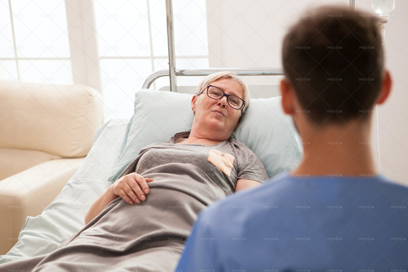 Paying Attention To Nurse: Stock Photos