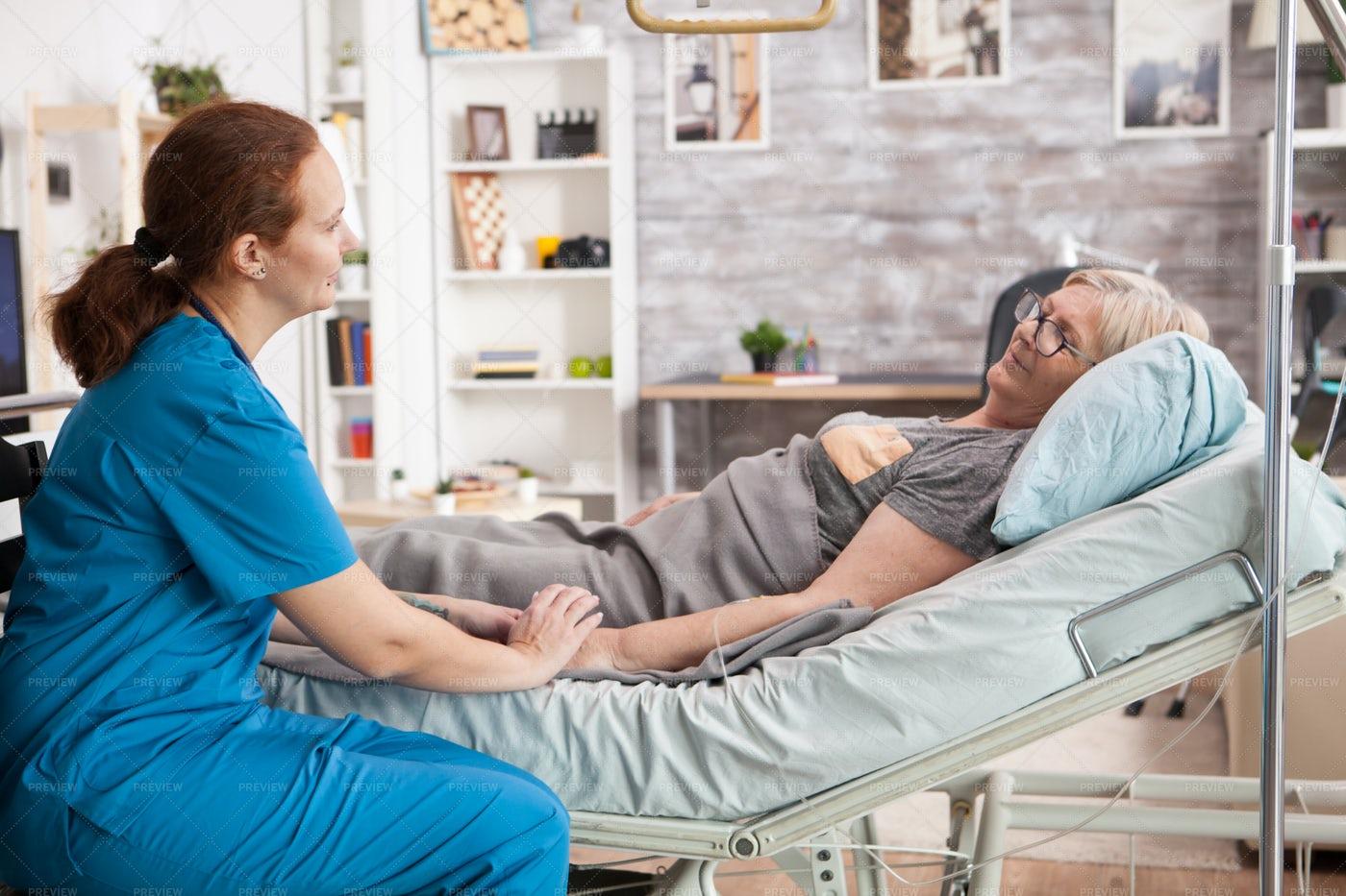 Nurse Consoling Patient: Stock Photos