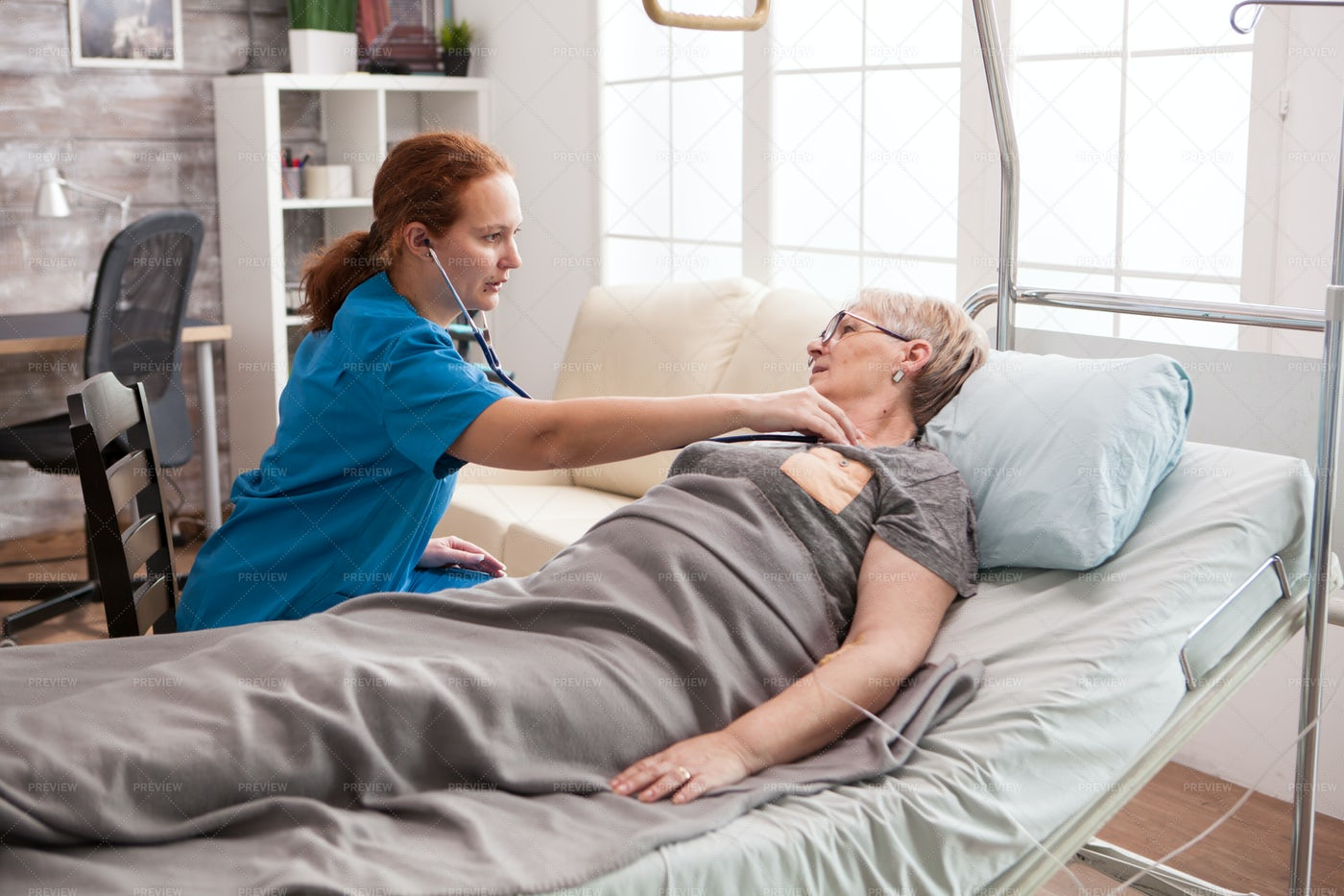 Patient Checkup In Bed: Stock Photos