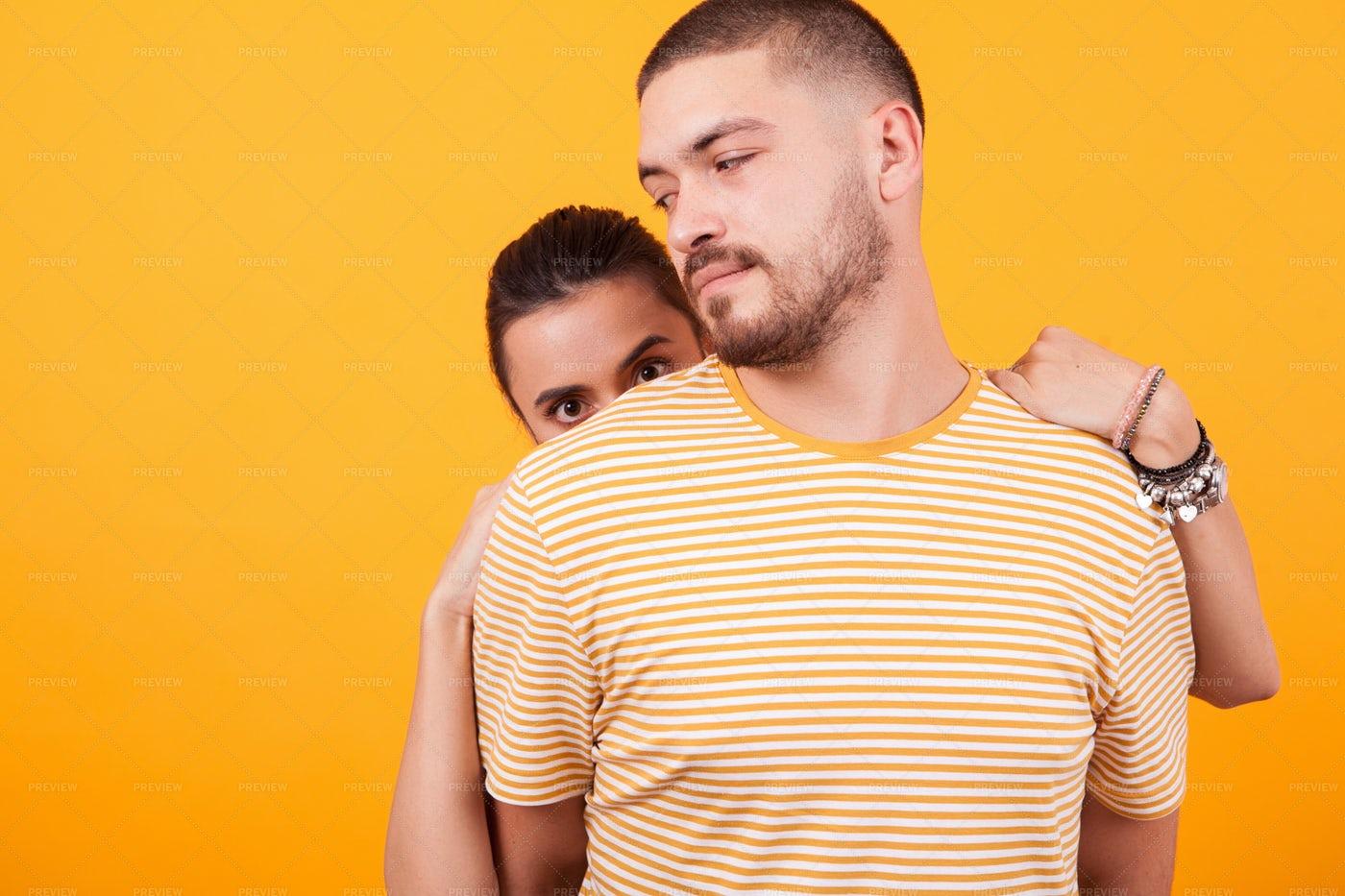 Peeking Behind Boyfriend: Stock Photos