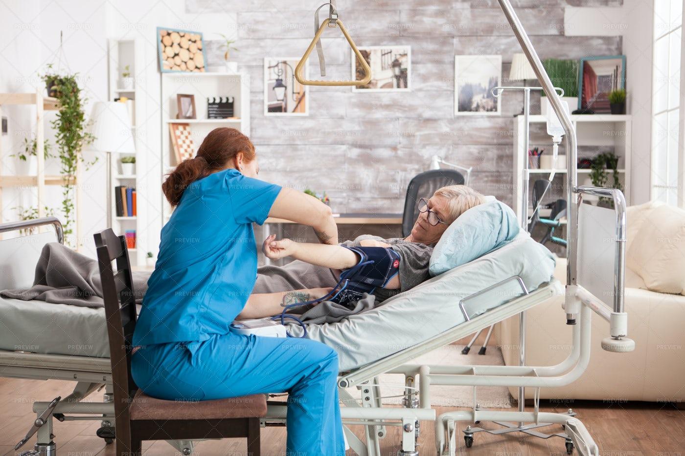 Nurse Attaching Pressure Cuff: Stock Photos