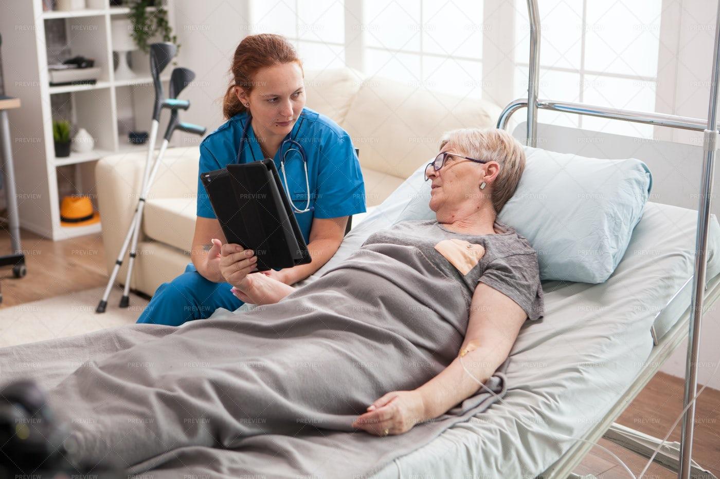 Home-Care Nurse Visits Woman: Stock Photos