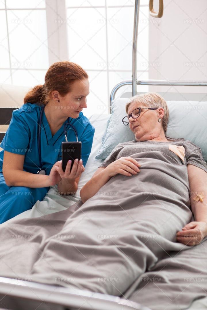 Caretaker Visits With Elderly Woman: Stock Photos