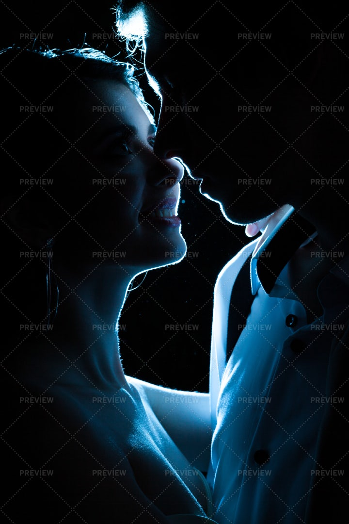 Newlyweds Kiss In Blue Light: Stock Photos