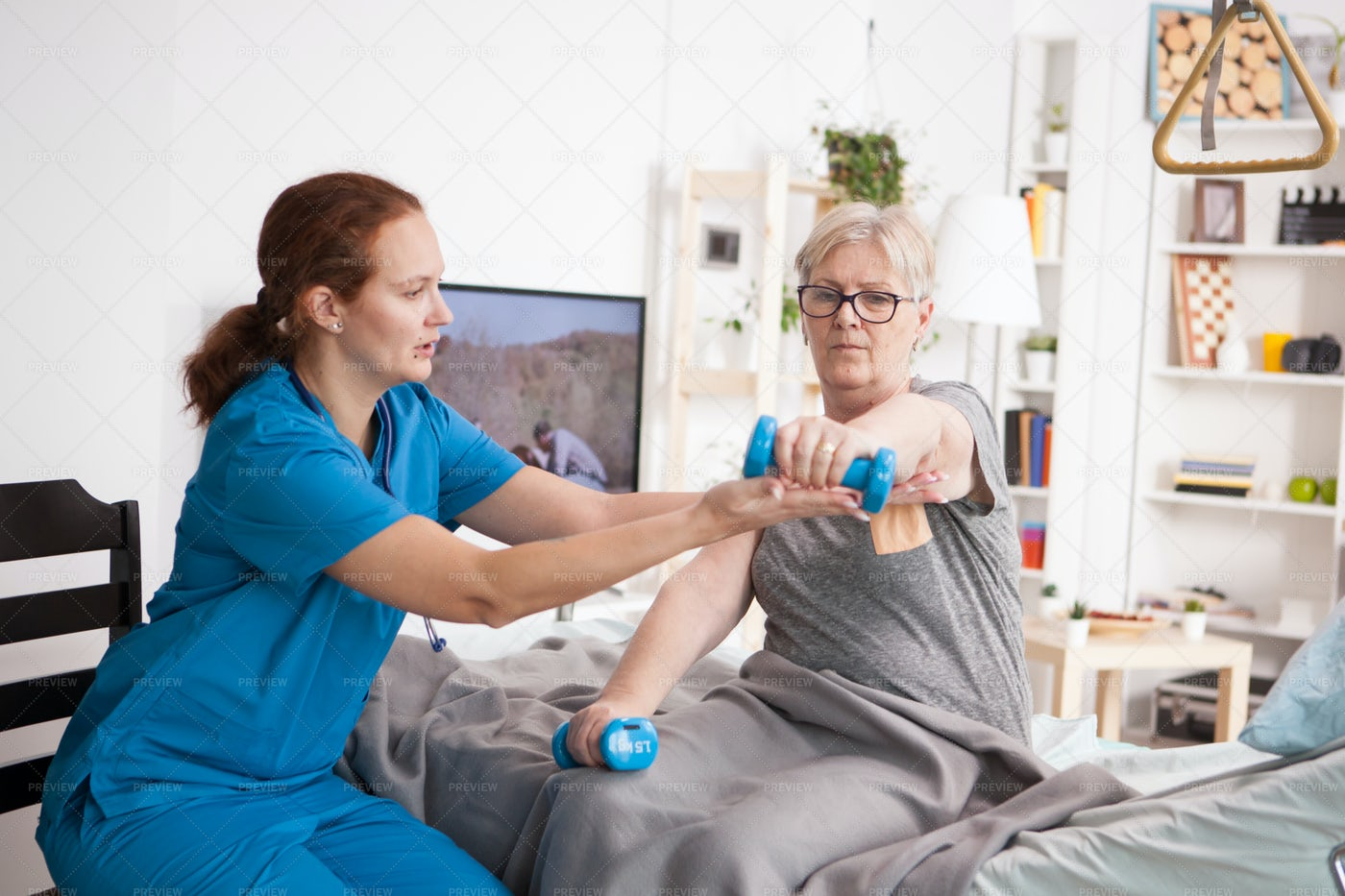 Caregiver Helping Patient Exercise: Stock Photos