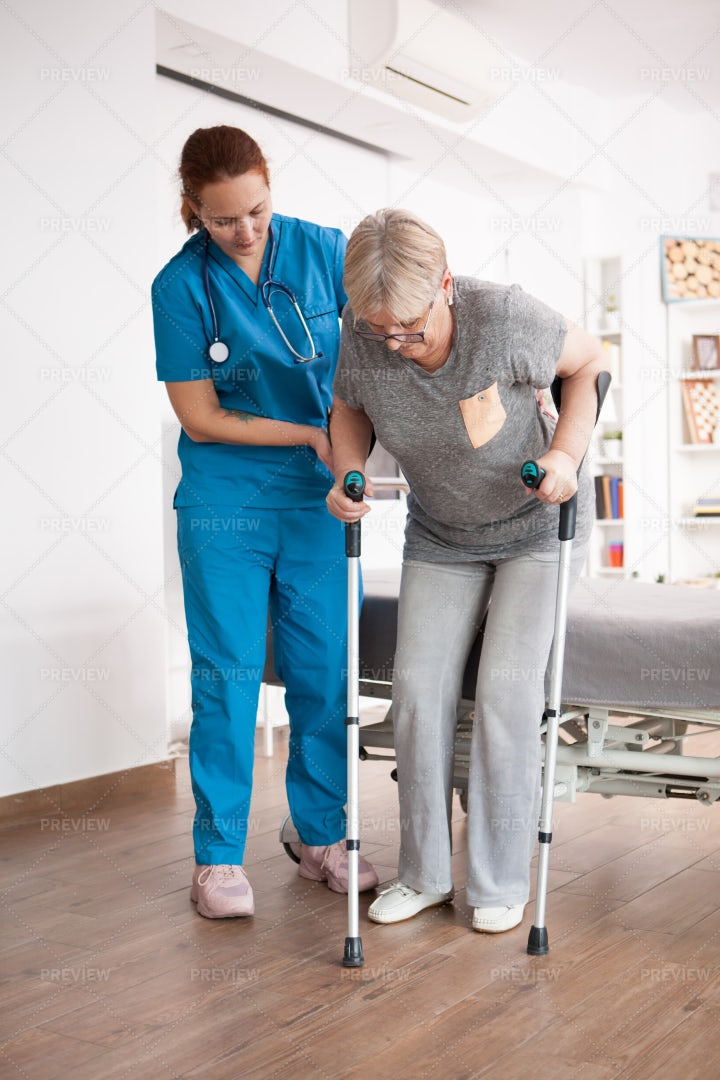Nurse Helping Patient Walk: Stock Photos