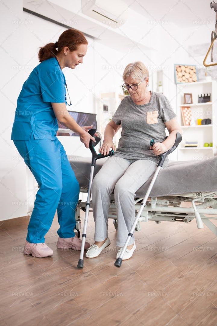 Nurse Assisting Patient: Stock Photos