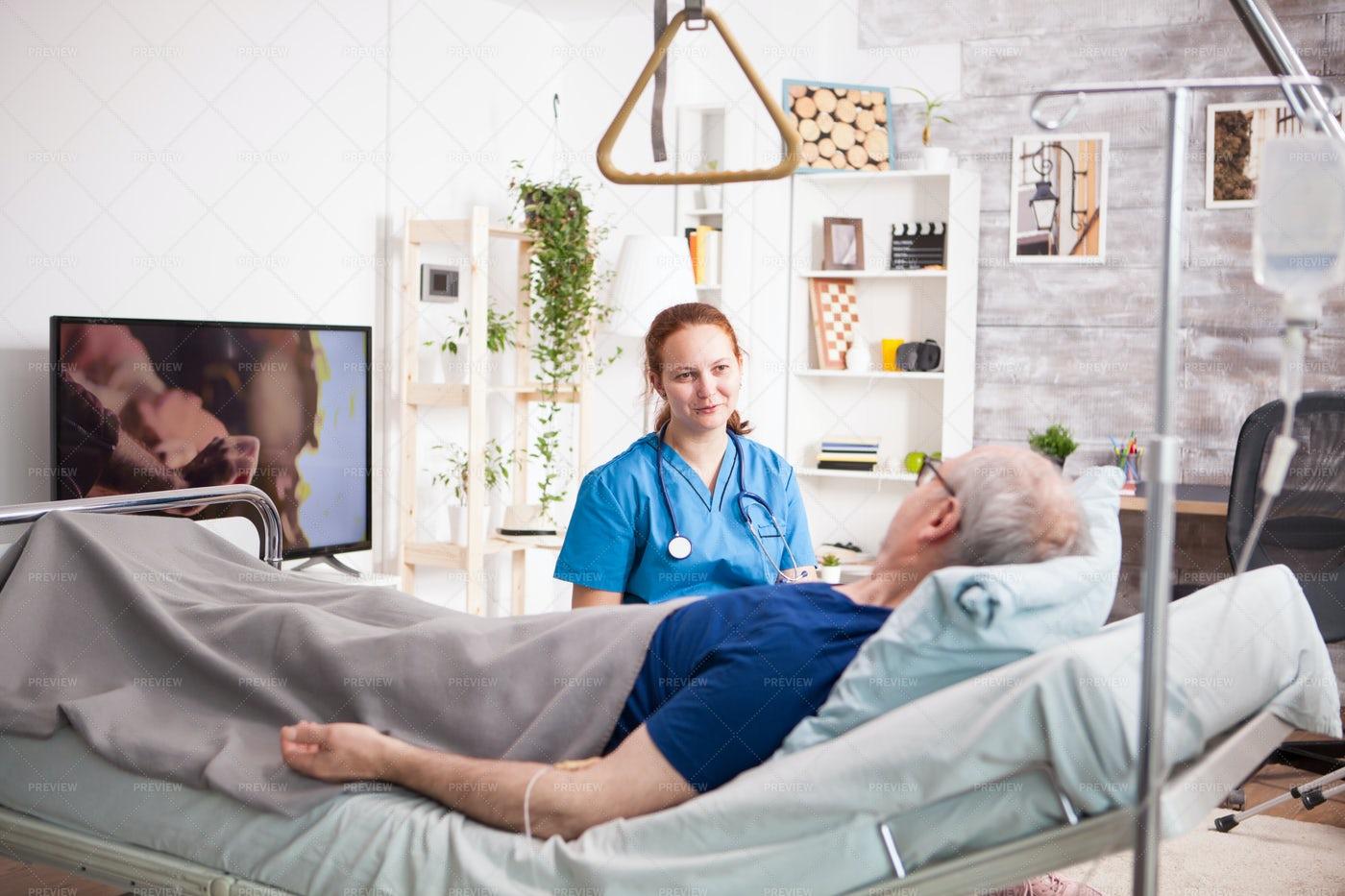 Man In Bed Beside Nurse: Stock Photos