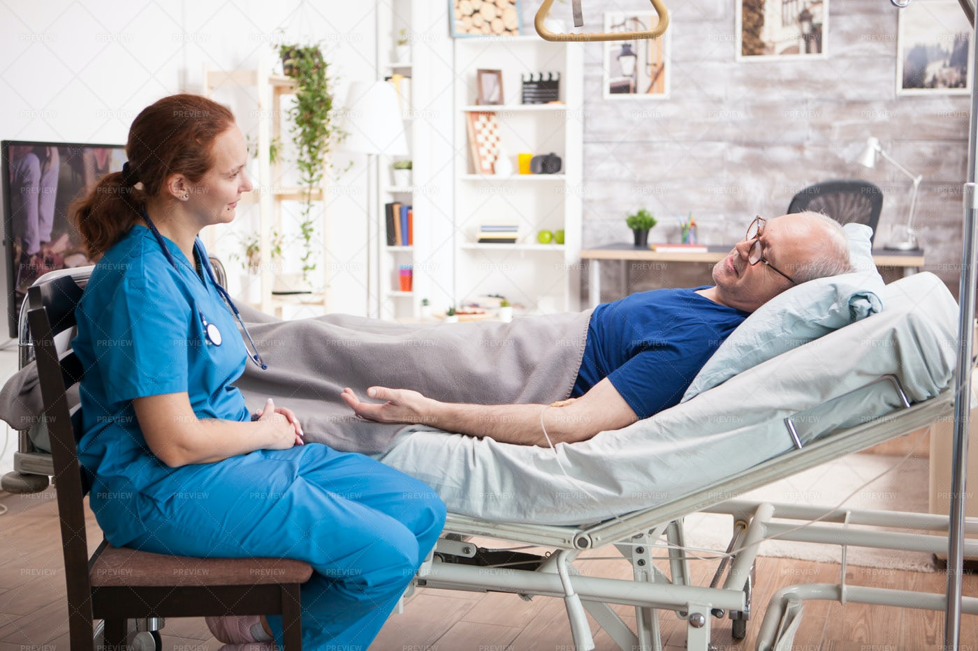 Visiting Elderly Man In Bed: Stock Photos