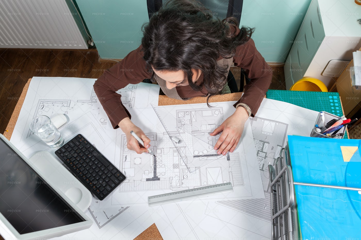 Architect Woman At Her Desk Working: Stock Photos
