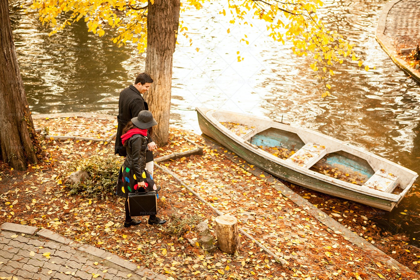 Couple Next To A Boat In Park: Stock Photos