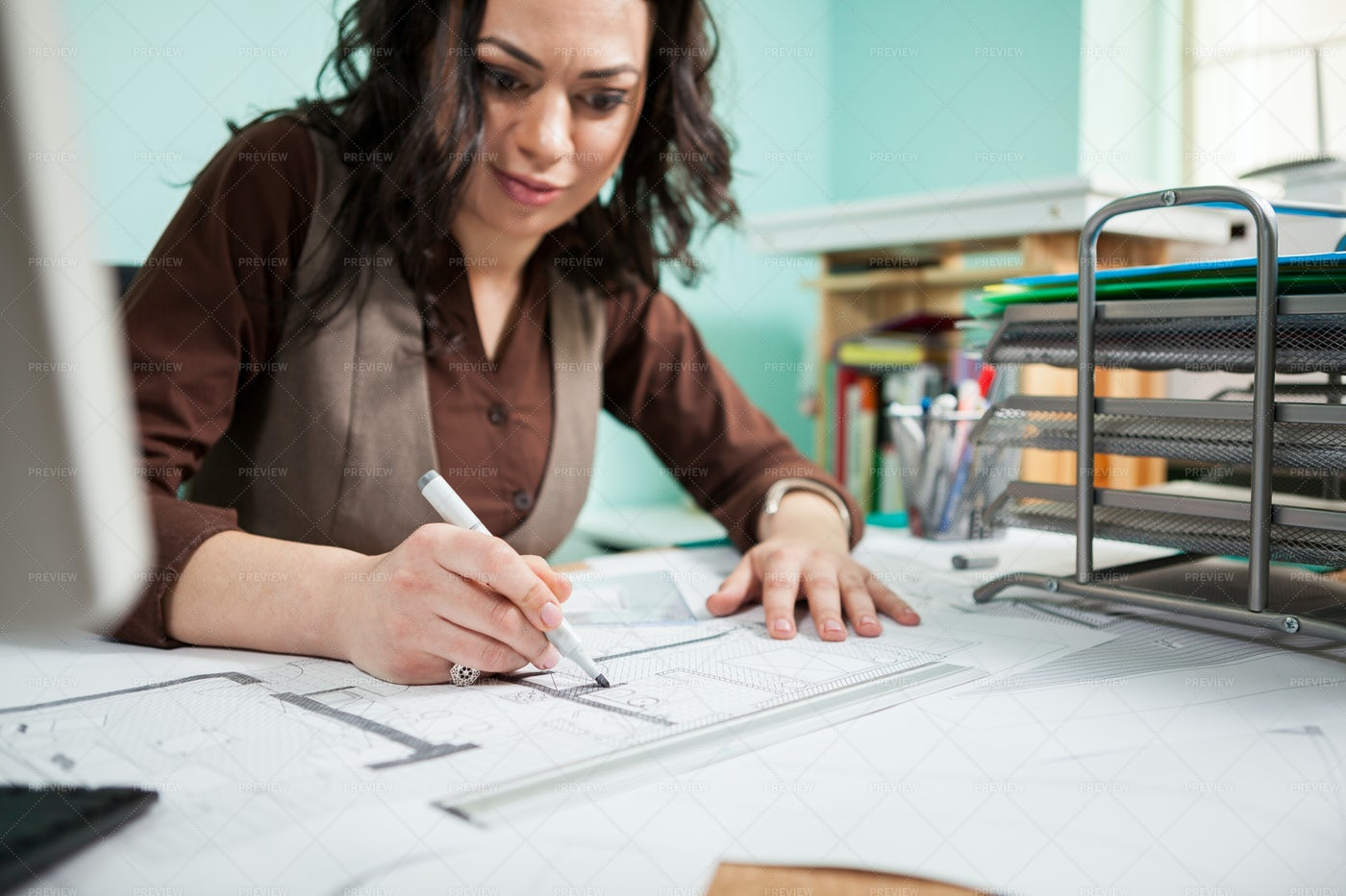 Architect Female At Her Working Desk: Stock Photos