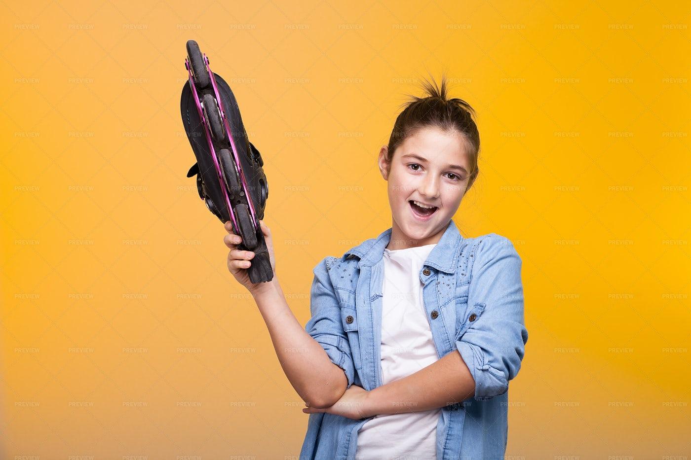 Girl Holding Roller Skate: Stock Photos