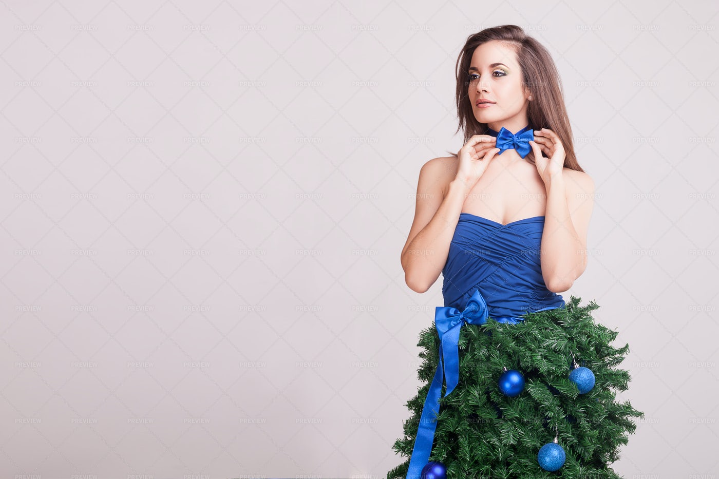 Tying Matching Blue Bow: Stock Photos