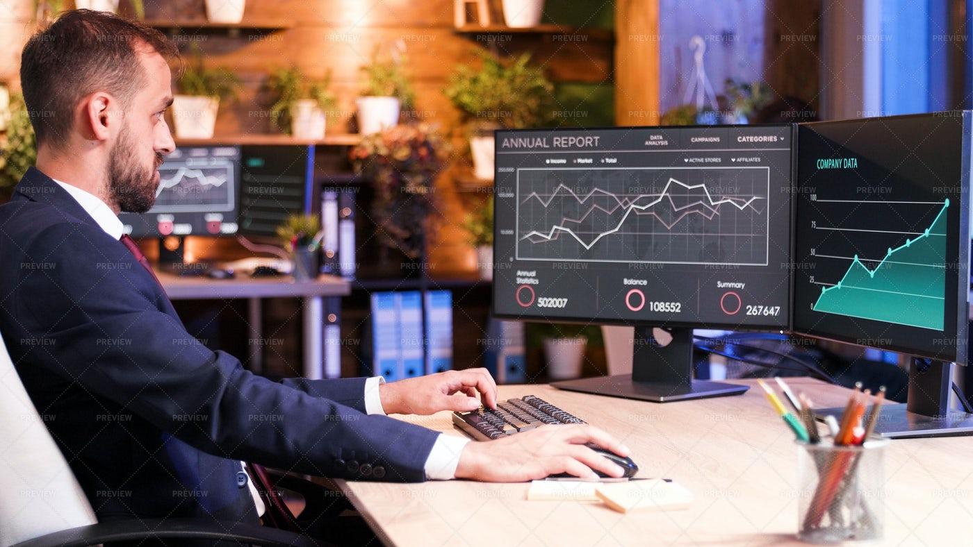 Manager Checking Statistics: Stock Photos