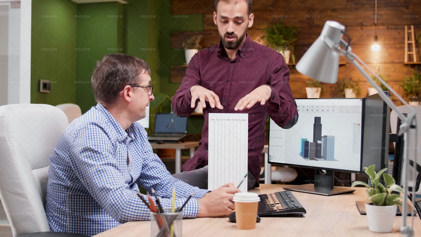 Two Architects In Cozy Office Talking: Stock Photos