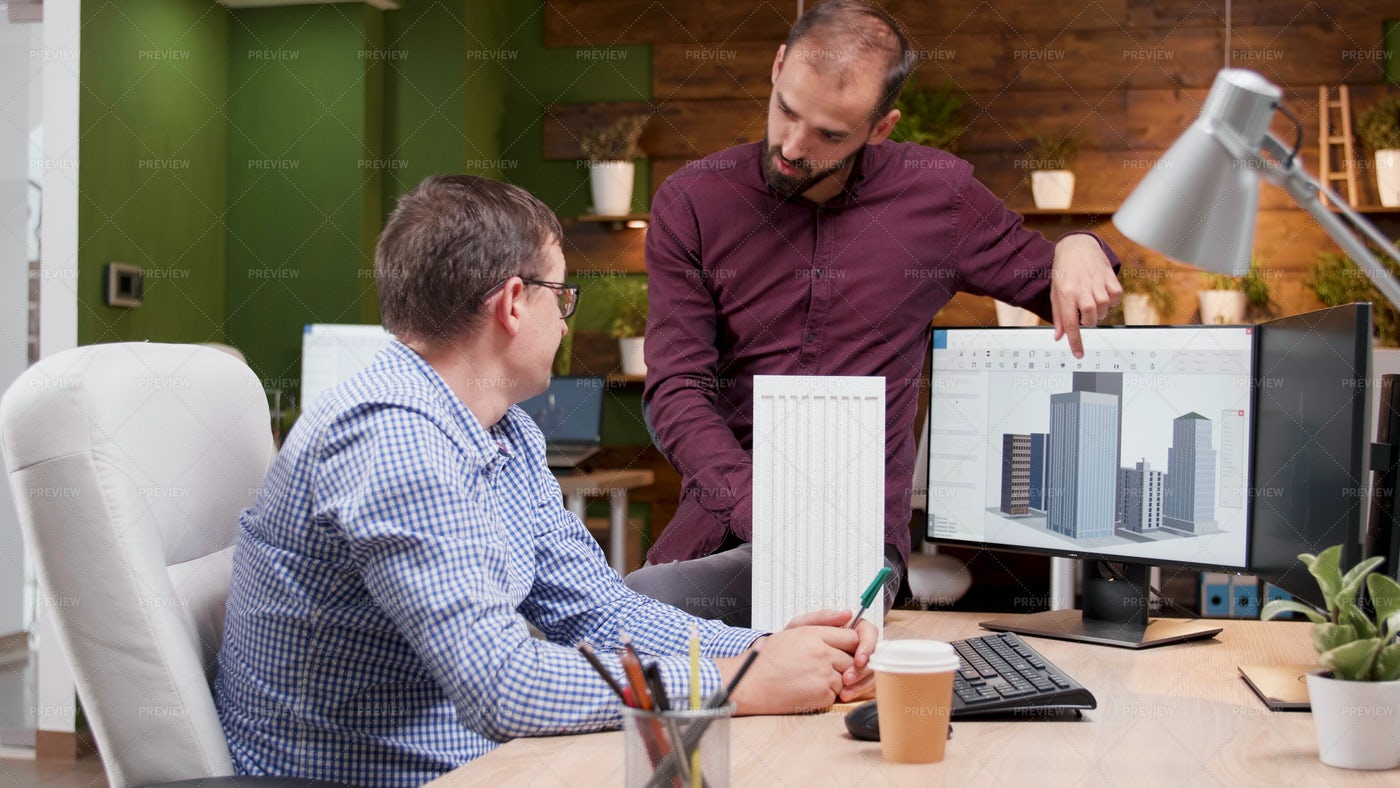 Architects Discussing Project: Stock Photos